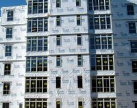 badly installed tyvek on an unfinished building