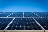 Solar photovoltaic (PV) panels cover a roof