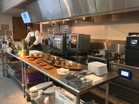 All-electric kitchens use induction cooktops and other energy-efficient equipment.