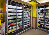 Refrigerated display case with vacuum-insulated glass doors