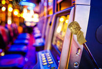 row of slot machines with golden donald trump handle