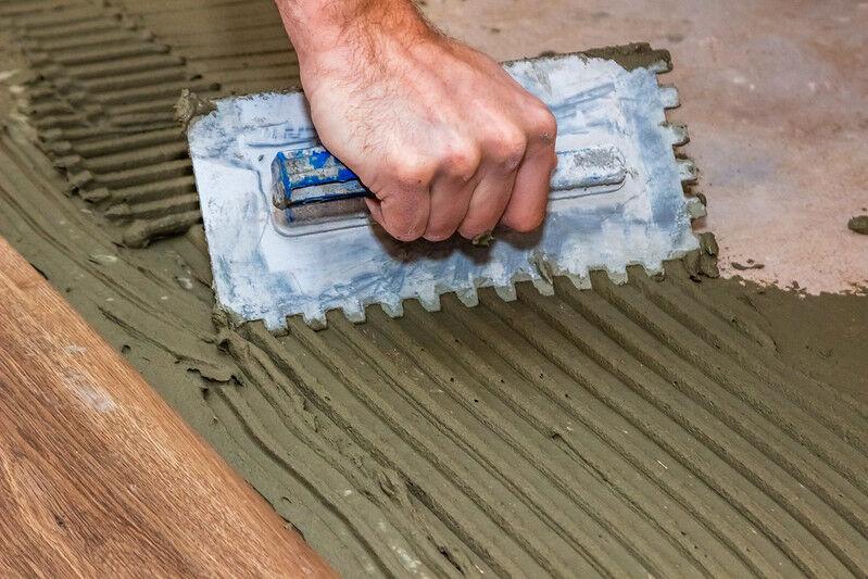 applying flooring adhesive