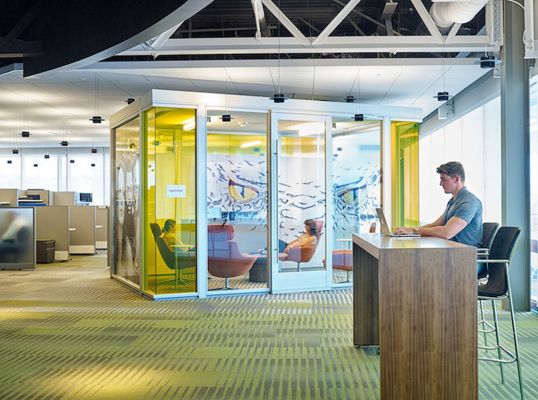 an office with an enclosed space created by movable partitions