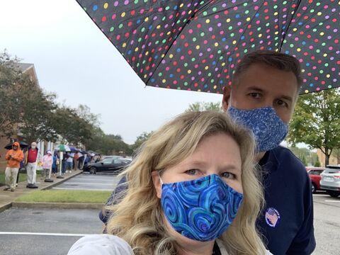 long voting line selfie in the rain