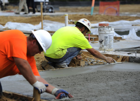 smoothing concrete at a building site
