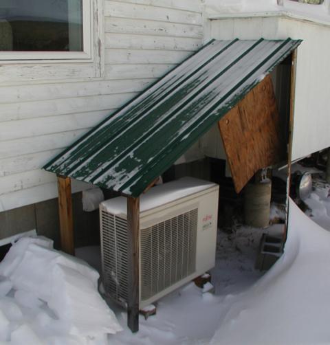shed roof installed over compressor for mini split heat pump