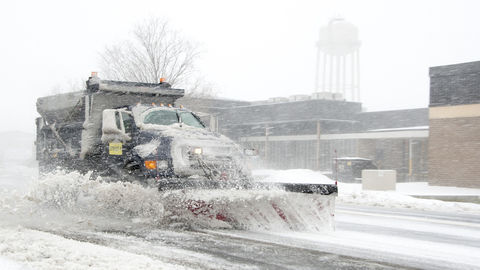 A dump truck snow plow clears snow from Purple Heart Drive during a snow storm March 5, 2015, on Dover Air Force Base, Delaware.